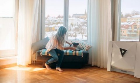 girl-and-dog-in-livingroom-e1553540704520